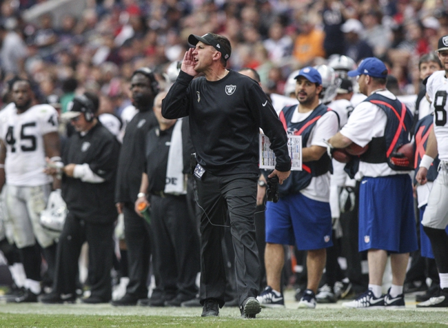 Nov 17, 2013; Houston, TX, USA; Oakland Raiders head coach Dennis Allen shouts from the sideline during the fourth quarter against the Houston Texans at Reliant Stadium. The Raiders defeated the Texans 28-23. Mandatory Credit: Troy Taormina-USA TODAY Sports