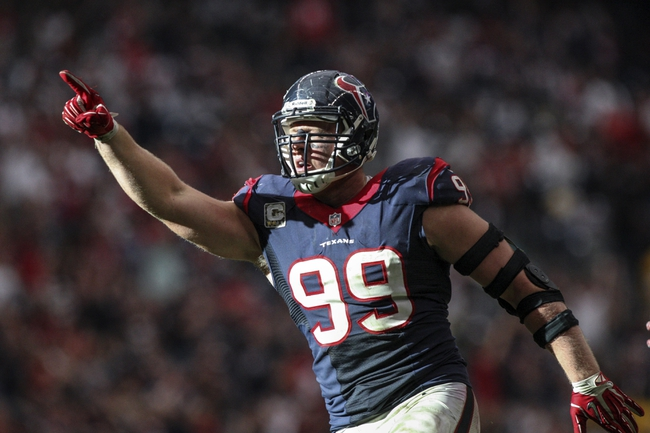 Nov 17, 2013; Houston, TX, USA; Houston Texans defensive end J.J. Watt (99) reacts after making a sack during the fourth quarter against the Oakland Raiders at Reliant Stadium. Mandatory Credit: Troy Taormina-USA TODAY Sports