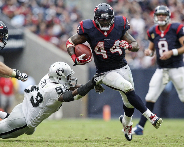 Nov 17, 2013; Houston, TX, USA; Houston Texans running back Ben Tate (44) rushes during the fourth quarter as Oakland Raiders middle linebacker Nick Roach (53) attempts to make a tackle at Reliant Stadium. The Raiders defeated the Texans 28-23. Mandatory Credit: Troy Taormina-USA TODAY Sports