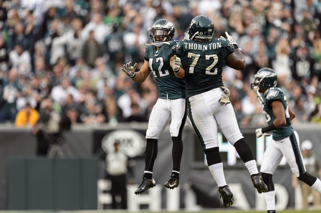 Nov 17, 2013; Philadelphia, PA, USA; Philadelphia Eagles safety Kurt Coleman (42) and defensive tackle Cedric Thornton (72) celebrate after the Washingt