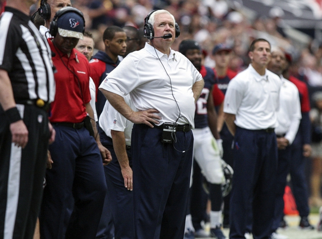 Nov 17, 2013; Houston, TX, USA; Houston Texans defensive coordinator Wade Phillips watches from the sideline during the third quarter against the Oakland Raiders at Reliant Stadium. The Raiders defeated the Texans 28-23. Mandatory Credit: Troy Taormina-USA TODAY Sports