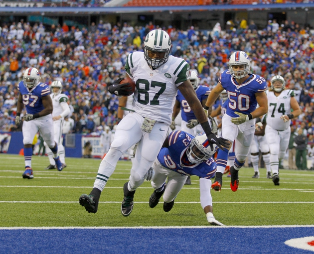 Nov 17, 2013; Orchard Park, NY, USA; New York Jets tight end Jeff Cumberland (87) runs the ball into the end zone for a second half touchdown while being defended by Buffalo Bills free safety Aaron Williams (23) at Ralph Wilson Stadium. Bills beat the Jets 37-14.  Mandatory Credit: Timothy T. Ludwig-USA TODAY Sports