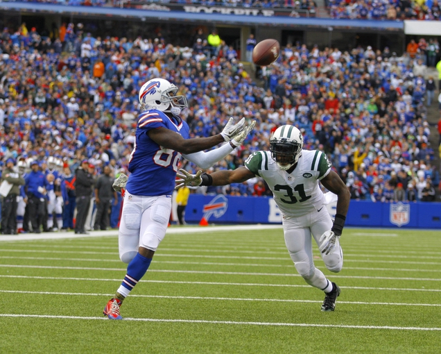 Nov 17, 2013; Orchard Park, NY, USA; Buffalo Bills wide receiver Marquise Goodwin (88) catches a ball for a touchdown while being defended by New York Jets cornerback Antonio Cromartie (31) during the second half at Ralph Wilson Stadium. Bills beat the Jets 37-14.  Mandatory Credit: Timothy T. Ludwig-USA TODAY Sports