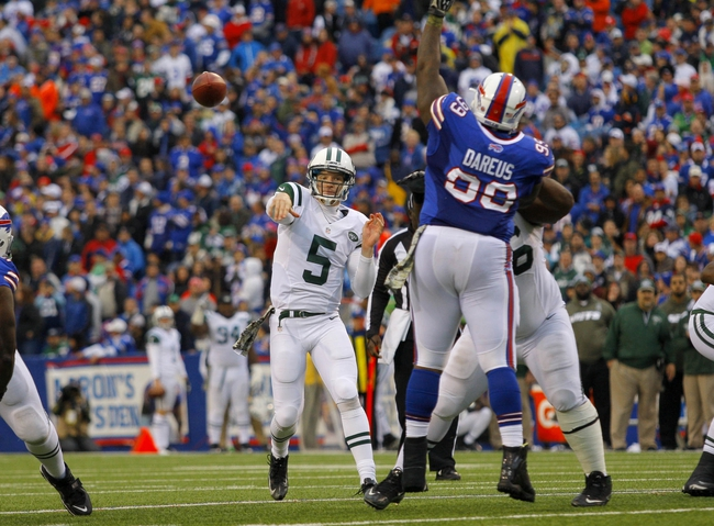 Nov 17, 2013; Orchard Park, NY, USA; New York Jets quarterback Matt Simms (5) throws a pass during the second half against the Buffalo Bills at Ralph Wilson Stadium. Bills beat the Jets 37-14.  Mandatory Credit: Timothy T. Ludwig-USA TODAY Sports