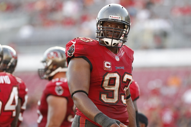 Nov 17, 2013; Tampa, FL, USA; Tampa Bay Buccaneers defensive tackle Gerald McCoy (93) smiles during the second half against the Atlanta Falcons at Raymond James Stadium. Tampa Bay Buccaneers defeated the Atlanta Falcons 41-28. Mandatory Credit: Kim Klement-USA TODAY Sports