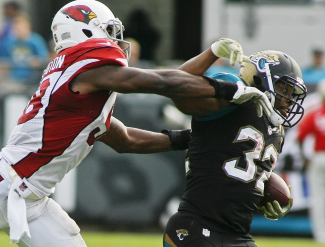 Nov 17, 2013; Jacksonville, FL, USA; Arizona Cardinals linebacker Daryl Washington (58) tries to push Jacksonville Jaguars running back Maurice Jones-Drew (32) out of bounds in the fourth quarter of their game at EverBank Field. The Arizona Cardinals beat the Jacksonville Jaguars 27-14. Mandatory Credit: Phil Sears-USA TODAY Sports