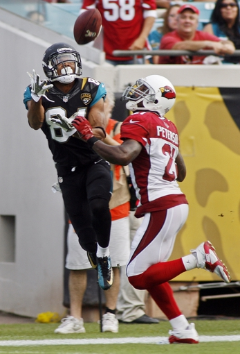 Nov 17, 2013; Jacksonville, FL, USA; On fourth down, Jacksonville Jaguars wide receiver Cecil Shorts III (84) leaps to catch a pass as Arizona Cardinals cornerback Patrick Peterson (21) defends in the fourth quarter of their game at EverBank Field. The pass was ruled incomplete when Shorts stepped out of bounds after making the catch. The Arizona Cardinals beat the Jacksonville Jaguars 27-14. Mandatory Credit: Phil Sears-USA TODAY Sports