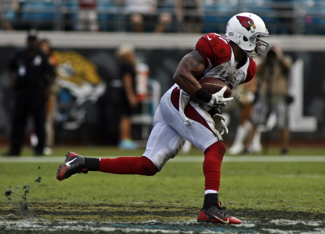 Nov 17, 2013; Jacksonville, FL, USA; Arizona Cardinals safety Yeremiah Bell (37) returns an interception late in the fourth quarter of their game against the Jacksonville Jaguars at EverBank Field. The Arizona Cardinals beat the Jacksonville Jaguars 27-14. Mandatory Credit: Phil Sears-USA TODAY Sports