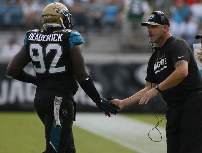 Nov 17, 2013; Jacksonville, FL, USA; Jacksonville Jaguars defensive tackle Brandon Deaderick (92) is congratulated by defensive line coach Todd Wash in the fourth quarter of their game against the Arizona Cardinals at EverBank Field. The Arizona Cardinals beat the Jacksonville Jaguars 27-14. Mandatory Credit: Phil Sears-USA TODAY Sports