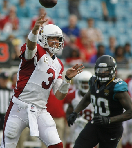 Nov 17, 2013; Jacksonville, FL, USA; Arizona Cardinals quarterback Carson Palmer (3) throws a pass as Jacksonville Jaguars defensive end Andre Branch (90) closes in during the fourth quarter of their game at EverBank Field. The Arizona Cardinals beat the Jacksonville Jaguars 27-14. Mandatory Credit: Phil Sears-USA TODAY Sports
