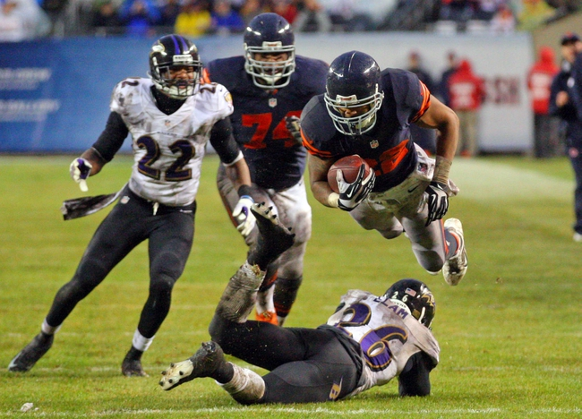 Nov 17, 2013; Chicago, IL, USA; Chicago Bears running back Matt Forte (22) leaps over Baltimore Ravens free safety Matt Elam (26) during the second half at Soldier Field. Chicago won 23-20 in overtime. Mandatory Credit: Dennis Wierzbicki-USA TODAY Sports