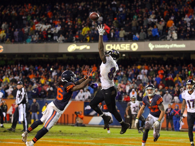 Nov 17, 2013; Chicago, IL, USA; Baltimore Ravens wide receiver Torrey Smith (82) leaps for and misses a pass with Chicago Bears cornerback Tim Jennings (26) defending during the second half at Soldier Field. Chicago won 23-20 in overtime. Mandatory Credit: Dennis Wierzbicki-USA TODAY Sports