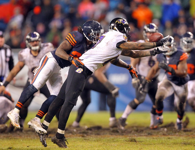 Nov 17, 2013; Chicago, IL, USA; Baltimore Ravens wide receiver Tandon Doss (17) dives for and misses a pass with Chicago Bears cornerback Tim Jennings (26) defending during the second half at Soldier Field. Chicago won 23-20 in overtime. Mandatory Credit: Dennis Wierzbicki-USA TODAY Sports