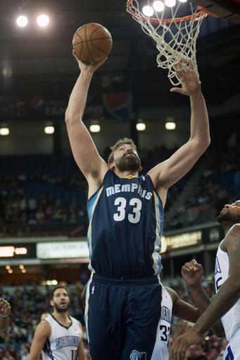 Nov 17, 2013; Sacramento, CA, USA; Memphis Grizzlies center Marc Gasol (33) dunks the ball against the Sacramento Kings during the first quarter at Sleep Train Arena. Mandatory Credit: Ed Szczepanski-USA TODAY Sports