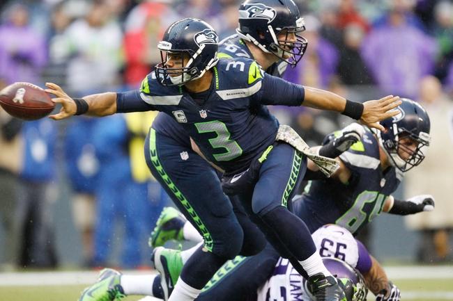 Nov 17, 2013; Seattle, WA, USA; Seattle Seahawks quarterback Russell Wilson (3) throws a touchdown pass against the Minnesota Vikings during the fourth quarter at CenturyLink Field. Mandatory Credit: Joe Nicholson-USA TODAY Sports