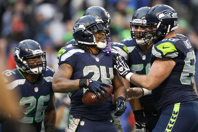 Nov 17, 2013; Seattle, WA, USA; Seattle Seahawks running back Marshawn Lynch (24) is congratulated by Seattle Seahawks center Max Unger (60) and Seattle Seahawks tackle Breno Giacomini (68) after making a touchdown reception against the Minnesota Vikings during the fourth quarter at CenturyLink Field. Mandatory Credit: Joe Nicholson-USA TODAY Sports