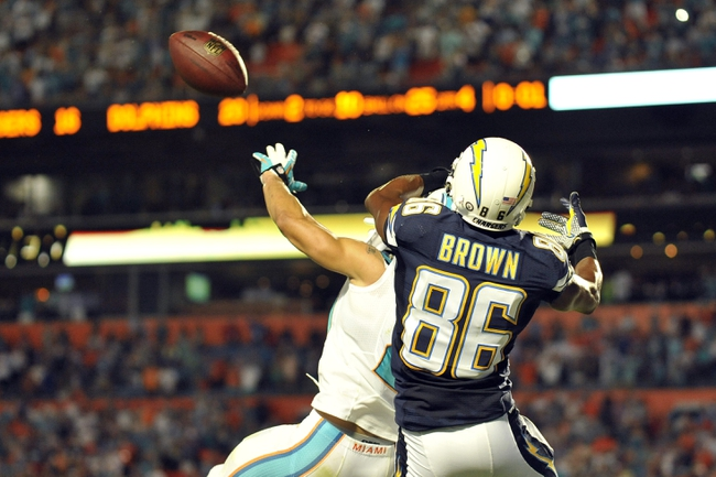 Nov 17, 2013; Miami Gardens, FL, USA; Miami Dolphins cornerback Brent Grimes (21) breaks up a hail mary pass to San Diego Chargers wide receiver Vincent Brown (86) during the last play of the game at Sun Life Stadium. The Dolphins won the game 20-16. Mandatory Credit: Joe Camporeale-USA TODAY Sports