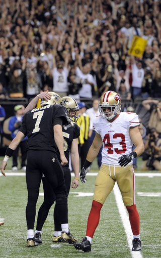 Nov 17, 2013; New Orleans, LA, USA; New Orleans Saints quarterback Luke McCown (7) congratulates kicker Garrett Hartley (5) on his game winning field goal against the San Francisco 49ers during the final two seconds of the fourth quarter at the Mercedes-Benz Superdome. The New Orleans Saints defeated the San Francisco 49ers 23-20. Mandatory Credit: John David Mercer-USA TODAY Sports