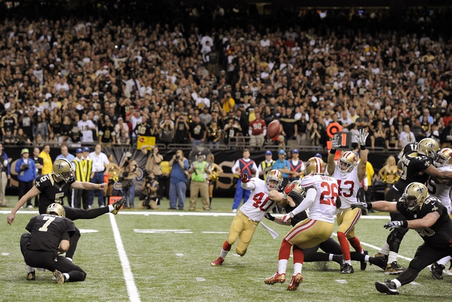 Nov 17, 2013; New Orleans, LA, USA; New Orleans Saints kicker Garrett Hartley (5) kicks the game winning field goal against the San Francisco 49ers in the final two seconds of the fourth quarter at the Mercedes-Benz Superdome. The New Orleans Saints defeated the San Francisco 49ers 23-20. Mandatory Credit: John David Mercer-USA TODAY Sports