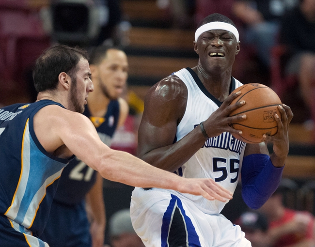 Nov 17, 2013; Sacramento, CA, USA; Sacramento Kings center Hamady Ndiaye (55) reacts to contact during the second quarter against the Memphis Grizzlies at Sleep Train Arena. The Memphis Grizzlies defeated the Sacramento Kings 97-86. Mandatory Credit: Ed Szczepanski-USA TODAY Sports