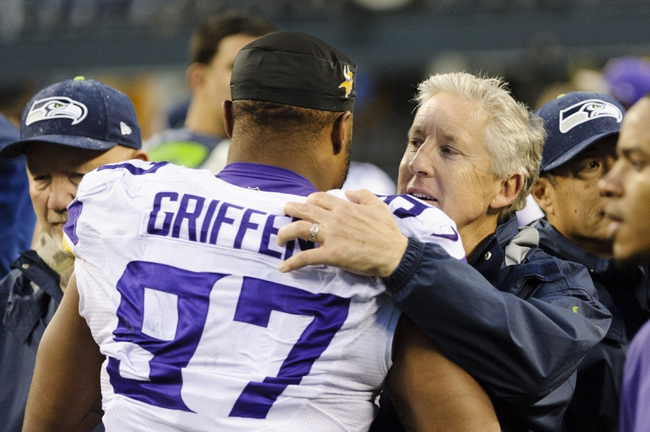Nov 17, 2013; Seattle, WA, USA; Seattle Seahawks head coach Pete Carroll hugs Minnesota Vikings defensive end Everson Griffen (97) after the game at CenturyLink Field. Seattle defeated Minnesota 41-20. Mandatory Credit: Steven Bisig-USA TODAY Sports