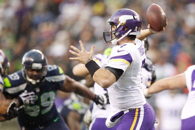 Nov 17, 2013; Seattle, WA, USA; Minnesota Vikings quarterback Christian Ponder (7) passes against the Seattle Seahawks during the third quarter at CenturyLink Field. Mandatory Credit: Joe Nicholson-USA TODAY Sports