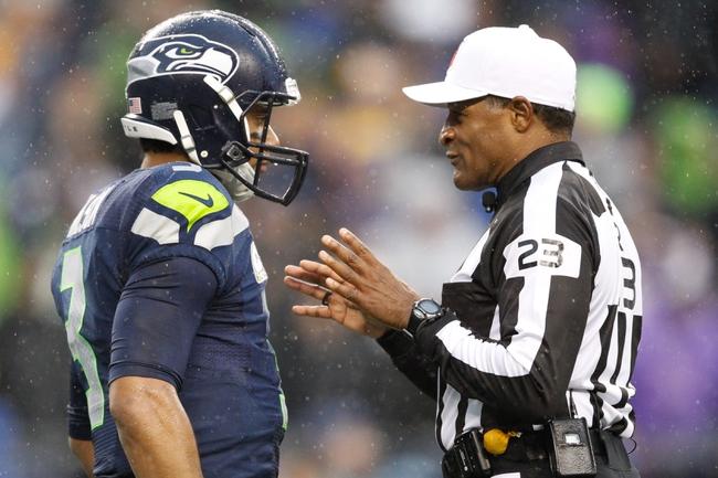 Nov 17, 2013; Seattle, WA, USA; Seattle Seahawks quarterback Russell Wilson (3) talks with referee Jerom Boger (23) during a third quarter timeout against the Minnesota Vikings at CenturyLink Field. Mandatory Credit: Joe Nicholson-USA TODAY Sports