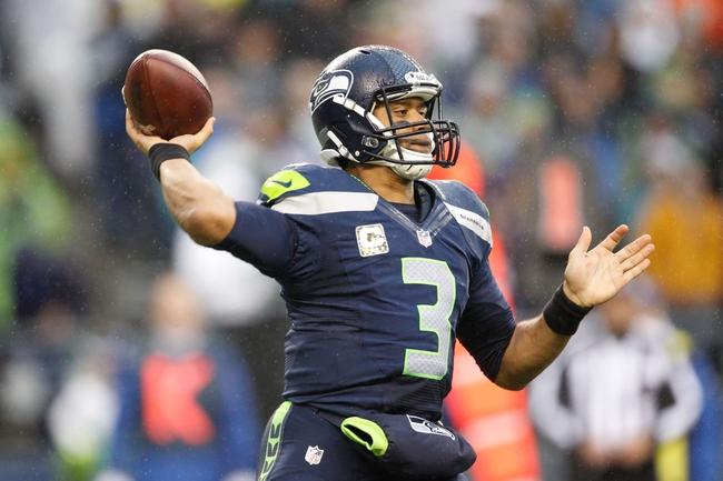 Nov 17, 2013; Seattle, WA, USA; Seattle Seahawks quarterback Russell Wilson (3) passes against the Minnesota Vikings during the third quarter at CenturyLink Field. Mandatory Credit: Joe Nicholson-USA TODAY Sports
