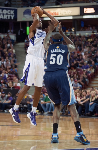 Nov 17, 2013; Sacramento, CA, USA; Sacramento Kings small forward Travis Outlaw (25) takes a shot over Memphis Grizzlies power forward Zach Randolph (50) during the third quarter at Sleep Train Arena. The Memphis Grizzlies d