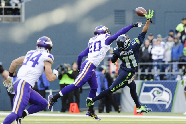 Nov 17, 2013; Seattle, WA, USA; Seattle Seahawks wide receiver Percy Harvin (11) catches a pass while being defended by Minnesota Vikings cornerback Chris Cook (20) during the first half at CenturyLink Field. Seattle defeated Minnesota 41-20. Mandatory Credit: Steven Bisig-USA TODAY Sports