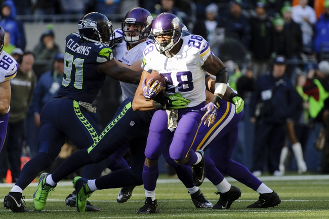 Nov 17, 2013; Seattle, WA, USA; Minnesota Vikings running back Adrian Peterson (28) carries the ball against the Seattle Seahawks during the first half at CenturyLink Field. Seattle defeated Minnesota 41-20. Mandatory Credit: Steven Bisig-USA TODAY Sports