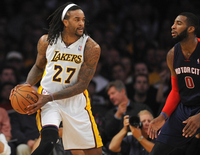November 17, 2013; Los Angeles, CA, USA; Los Angeles Lakers center Jordan Hill (27) controls the ball against the defense of Detroit Pistons center Andre Drummond (0) during the first half at Staples Center. Mandatory Credit: Gary A. Vasquez-USA TODAY Sports