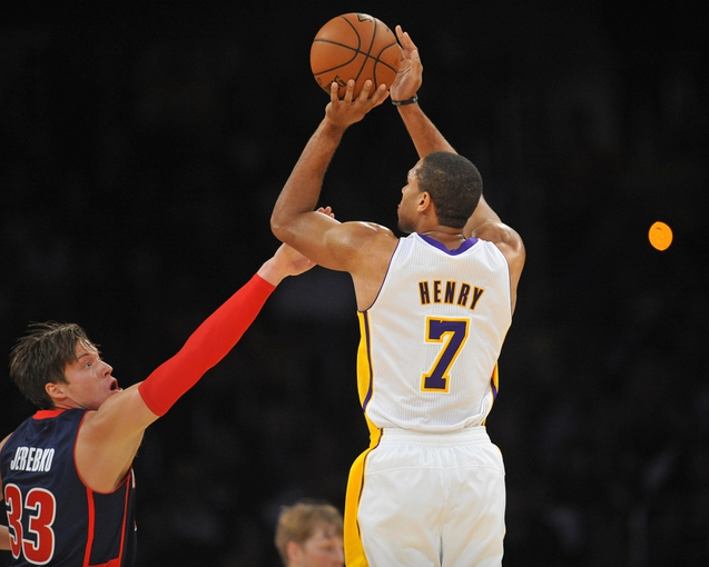 November 17, 2013; Los Angeles, CA, USA; Los Angeles Lakers small forward Xavier Henry (7) shoots a basket against the defense of Detroit Pistons power forward Jonas Jerebko (33) during the first half at Staples Center. Mandatory Credit: Gary A. Vasquez-USA TODAY Sports