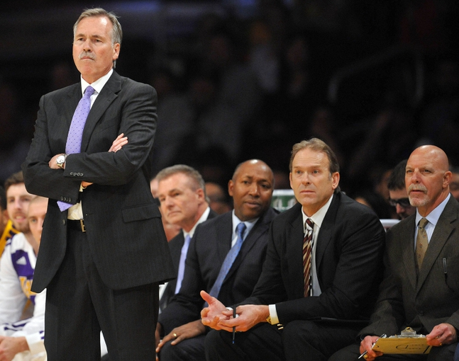 November 17, 2013; Los Angeles, CA, USA; Los Angeles Lakers head coach Mike D'Antoni, assistant coach Johnny Davis, assistant coach Kurt Rambis and trainer Gary Vitti watch game action against the Detroit Pistons during the first half at Staples Center. Mandatory Credit: Gary A. Vasquez-USA TODAY Sports