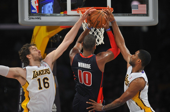 November 17, 2013; Los Angeles, CA, USA; Detroit Pistons power forward Greg Monroe (10) goes in for a basket against the defense of Los Angeles Lakers center Pau Gasol (16) and power forward Shawne Williams (3) during the second half at Staples Center. Mandatory Credit: Gary A. Vasquez-USA TODAY Sports