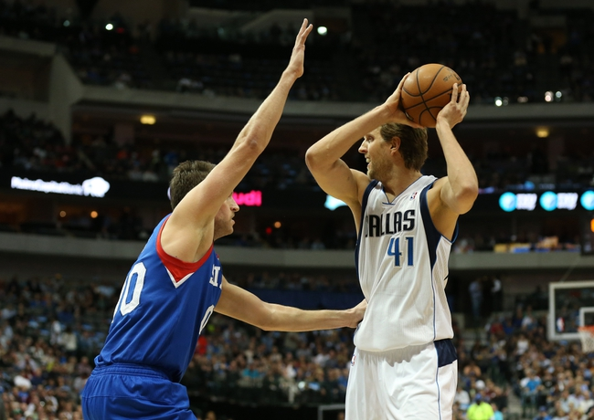 Nov 18, 2013; Dallas, TX, USA; Dallas Mavericks forward Dirk Nowitzki (41) looks to pass against Philadelphia 76ers center Spencer Hawes (00) in the first quarter at American Airlines Center. Mandatory Credit: Matthew Emmons-USA TODAY Sports