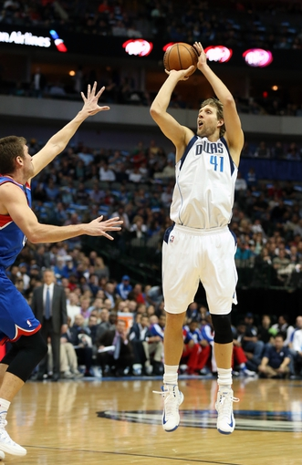 Nov 18, 2013; Dallas, TX, USA; Dallas Mavericks forward Dirk Nowitzki (41) shoots a three point basket against the Philadelphia 76ers at American Airlines Center. Mandatory Credit: Matthew Emmons-USA TODAY Sports