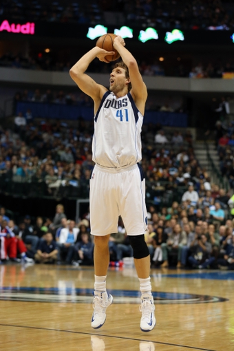 Nov 18, 2013; Dallas, TX, USA; Dallas Mavericks forward Dirk Nowitzki (41) shoots against the Philadelphia 76ers at American Airlines Center. Mandatory Credit: Matthew Emmons-USA TODAY Sports