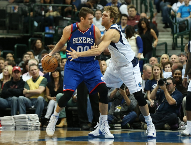 Nov 18, 2013; Dallas, TX, USA; Dallas Mavericks forward Dirk Nowitzki (41) tips the ball away from Philadelphia 76ers center Spencer Hawes (00) in the first quarter at American Airlines Center. Mandatory Credit: Matthew Emmons-USA TODAY Sports