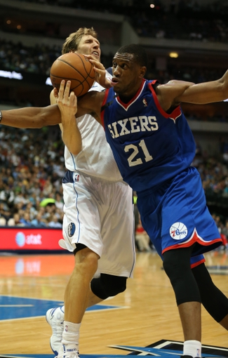 Nov 18, 2013; Dallas, TX, USA; Dallas Mavericks forward Dirk Nowitzki (41) is fouled by Philadelphia 76ers forward Thaddeus Young (21) in the second quarter at American Airlines Center. Mandatory Credit: Matthew Emmons-USA TODAY Sports
