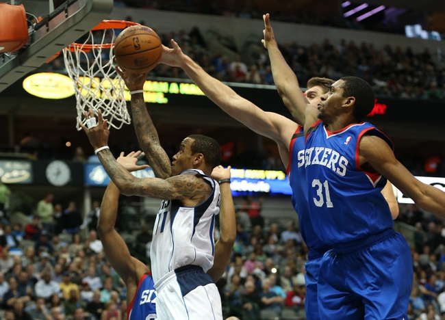Nov 18, 2013; Dallas, TX, USA; Dallas Mavericks guard Monta Ellis (11) shoots against Philadelphia 76ers forward Hollis Thompson (31) and center Spencer Hawes (00) in the second quarter at American Airlines Center. Mandatory Credit: Matthew Emmons-USA TODAY Sports