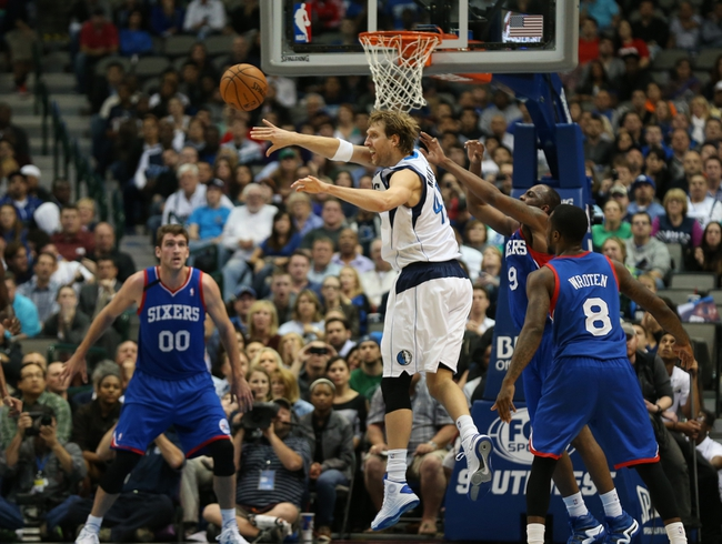 Nov 18, 2013; Dallas, TX, USA; Dallas Mavericks forward Dirk Nowitzki (41) passes the ball in the fourth quarter against the Philadelphia 76ers at American Airlines Center. Mandatory Credit: Matthew Emmons-USA TODAY Sports