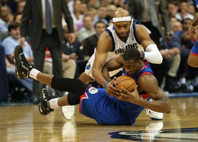 Nov 18, 2013; Dallas, TX, USA; Dallas Mavericks guard Vince Carter (25) fights for a loose ball with against Philadelphia 76ers forward Thaddeus Young (21) in the fourth quarter at American Airlines Center. The Mavs beat the 76ers 97-94. Mandatory Credit: Matthew Emmons-USA TODAY Sports