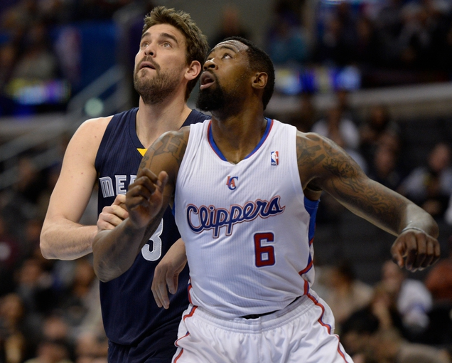 Nov 18, 2013; Los Angeles, CA, USA; Memphis Grizzlies center Marc Gasol (33) and Los Angeles Clippers center DeAndre Jordan (6) get in rebounding position under the hoop during first quarter action at Staples Center. Mandatory Credit: Robert Hanashiro-USA TODAY Sports