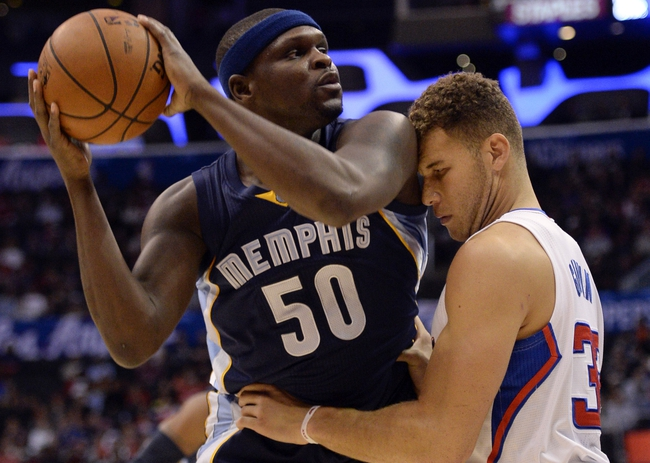 Nov 18, 2013; Los Angeles, CA, USA; Los Angeles Clippers power forward Blake Griffin (32) gets up close as he defends Memphis Grizzlies power forward Zach Randolph (50) during first half action at Staples Center. Mandatory Credit: Robert Hanashiro-USA TODAY Sports