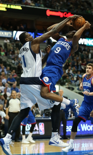 Nov 18, 2013; Dallas, TX, USA; Dallas Mavericks center Samuel Dalembert (1) blocks the shot of Philadelphia 76ers guard James Anderson (9) in the second half at American Airlines Center. The Mavs beat the 76ers 97-94. Mandatory Credit: Matthew Emmons-USA TODAY Sports