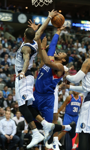 Nov 18, 2013; Dallas, TX, USA; Dallas Mavericks guard Monta Ellis (11) blocks a shot against Philadelphia 76ers guard Darius Morris (7) in the second half at American Airlines Center. The Mavs beat the 76ers 97-94. Mandatory Credit: Matthew Emmons-USA TODAY Sports