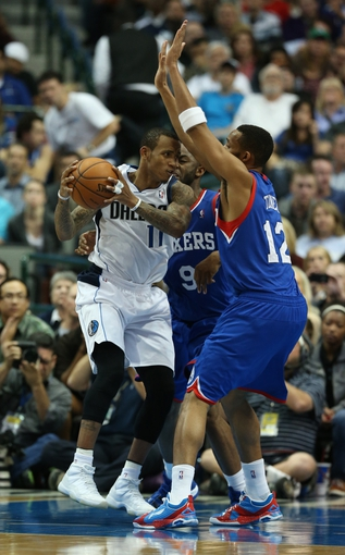 Nov 18, 2013; Dallas, TX, USA; Dallas Mavericks guard Monta Ellis (11) is double teamed in the second half by Philadelphia 76ers guard James Anderson (9) and forward Evan turner (12) at American Airlines Center. The Mavs beat the 76ers 97-94. Mandatory Credit: Matthew Emmons-USA TODAY Sports