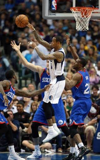 Nov 18, 2013; Dallas, TX, USA; Dallas Mavericks guard Monta Ellis (11) passes on a drive in the second half against Philadelphia 76ers center Spencer Hawes (00) and forward Thaddeus Young (21) at American Airlines Center. The Mavs beat the 76ers 97-94. Mandatory Credit: Matthew Emmons-USA TODAY Sports
