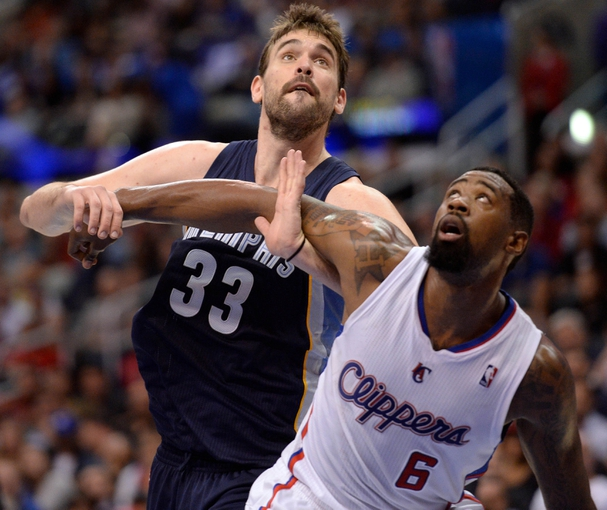 Nov 18, 2013; Los Angeles, CA, USA; Memphis Grizzlies center Marc Gasol (33) and Los Angeles Clippers center DeAndre Jordan (6) battle for rebounding postion during second quarter action at Staples Center. Mandatory Credit: Robert Hanashiro-USA TODAY Sports
